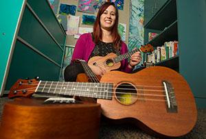 Tori Steely, UC Davis Children's Hospital music therapist, posed with a Ukulele Kids Club uke