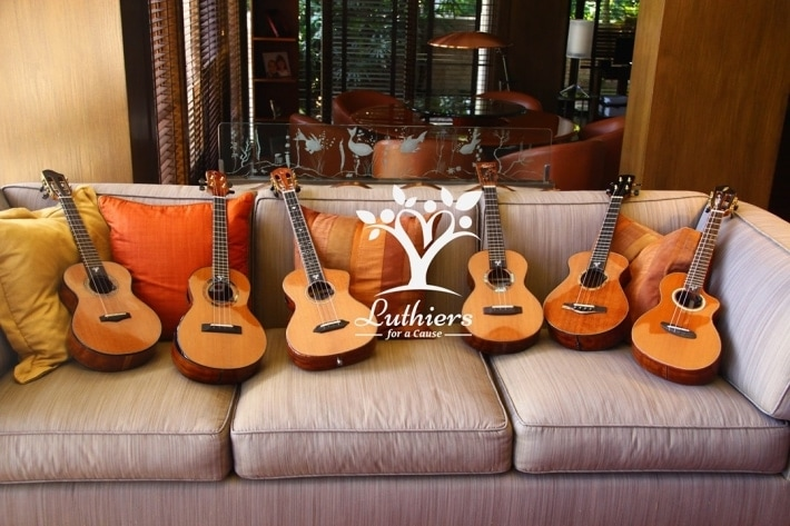 Six beautiful, precisely crafted tenor ukulele lined up on a couch