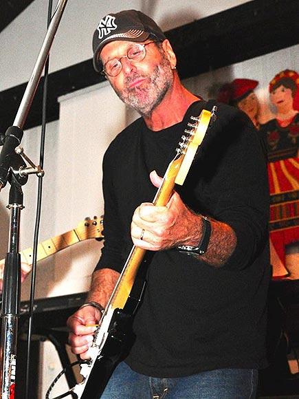 Corey Bergman playing an electric guitar